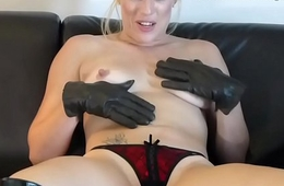 Kinky blonde masturbates leather gloves