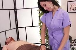 Gorgeous masseuse holds back clients orgasm